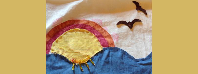 stof-kunst-zon-zee-regenboog